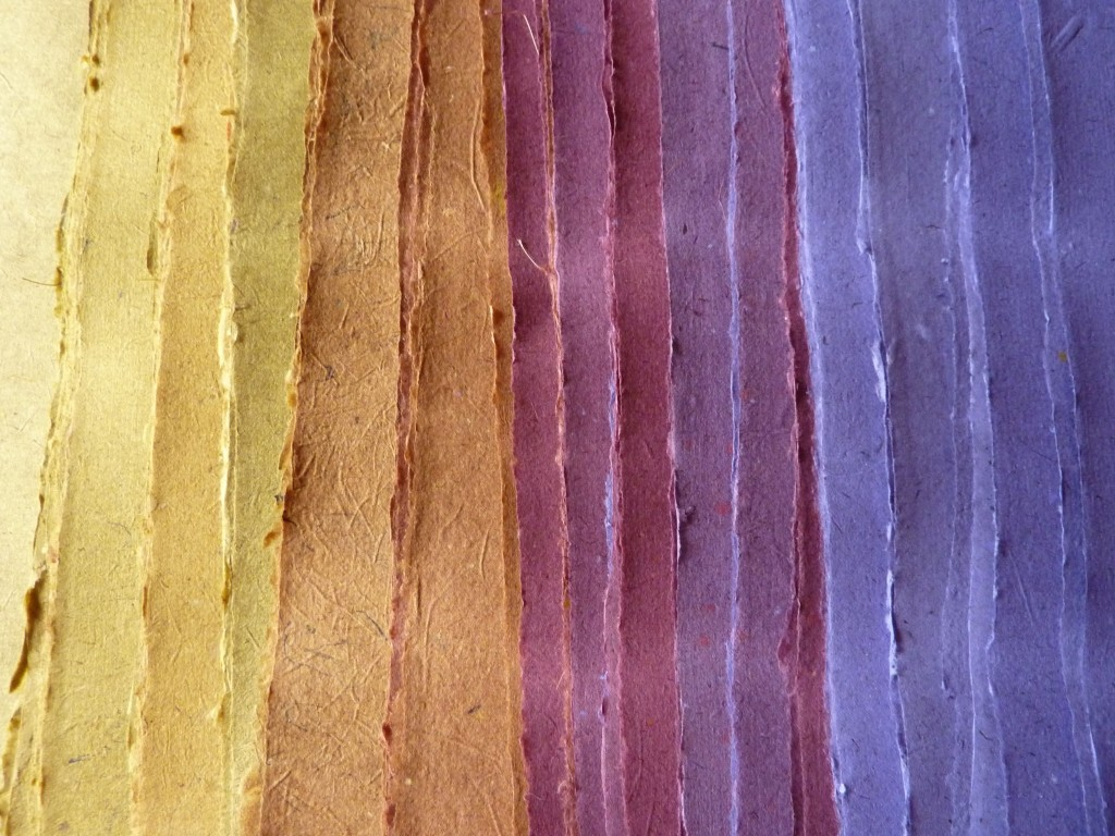 Dyed paper made with recycled rag board
